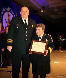 MCFRS Fire Chief Steve Lohr presents the award to President Goodloe